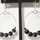 Hoop earrings black beads and silver bead caps on a silver plated hoop