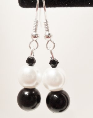 Black and white faux pearl dangle earrings with bicone bead