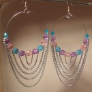 Hoop earrings ready for spring with colorful beads and chains