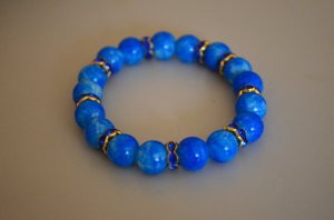 Blue and gold stretchy beaded bracelet with rhinestones and marbled beads