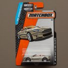 Matchbox 2015 MBX Adventure City Aston Martin DBS Volante (champagne)