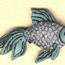 Fish button..realistic modern snap-together, green with lavender sparkle button