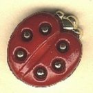 Beetle button..realistic modern snap-together, gold and red metalized plastic button