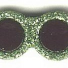 Sunglasses button..realistic modern snap-together, black and green with glitterplastic button
