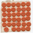 Original old card of stripped paper thin red and cream colored celluloid buttons