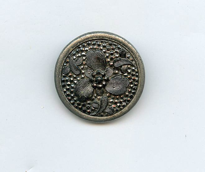 Lacy like black glass in metal flower button antique button
