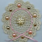 Crocheted doily with vintage pearlized buttons