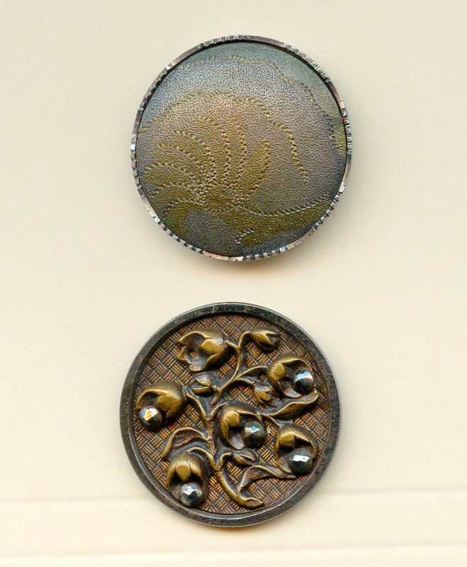 2 medium size steel cup buttons dated late 19th century