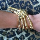 GOLD SKELETON GRIPPING HAND BONE TALON CLAW SKULL BRACELET CUFF