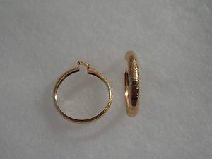 18 kt Gold Large Hoop Earrings