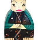 Hand-crafted Wood Figurine with Batik Motives, Relaxing Lady