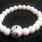 Handcrafted White Beads with Asian Focal Stretch Bracelet