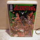 BLOODSTRIKE #8 VF OR BETTER