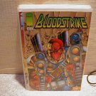 BLOODSTRIKE #11 VF OR BETTER
