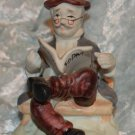 Old Man Sitting Reading Racing information Form Porcelain Figurine