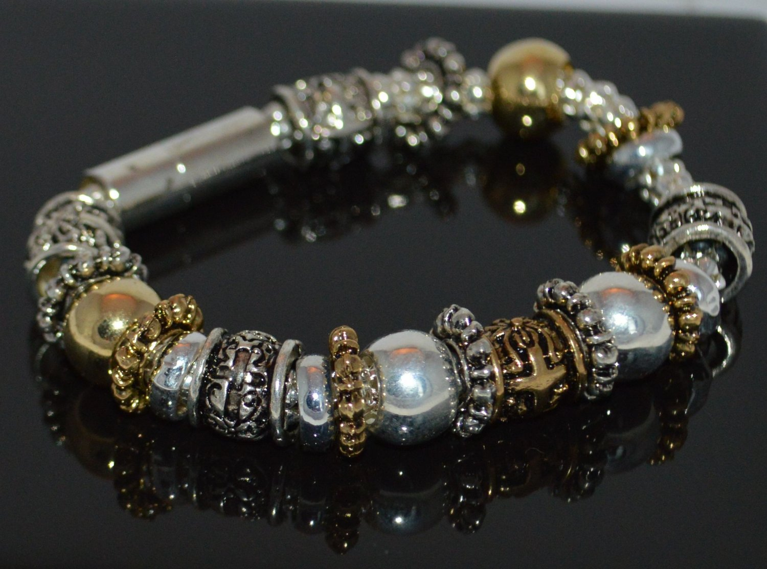 Gold and Silver Tone Metal Beads on Serpentine chain Magnetic Bracelet