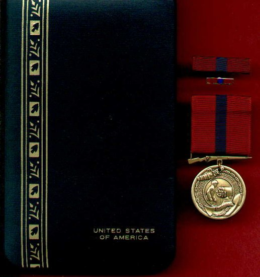 Marine Corps Good Conduct medal in case with ribbon bar and lapel pin