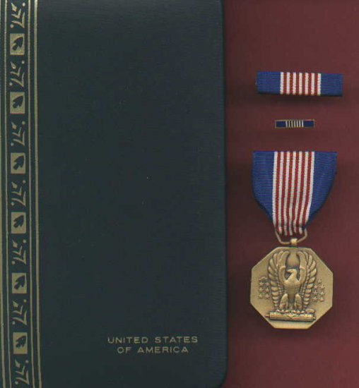 US Soldiers medal in case with ribbon bar and lapel pin