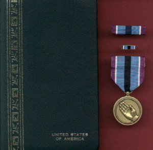 Humanitarian Service Award medal in case with ribbon bar and lapel pin