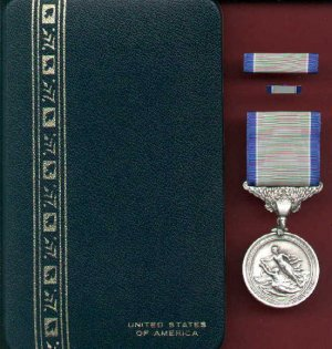 Silver Lifesaving medal in case with ribbon bar and lapel pin
