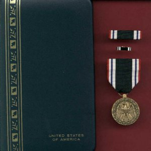 US Prisoner of War POW medal in case with ribbon bar and lapel pin