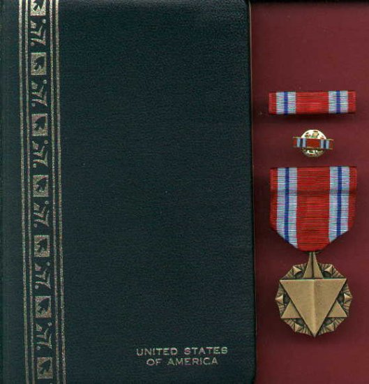 US Combat Readiness medal in case with ribbon bar and lapel pin