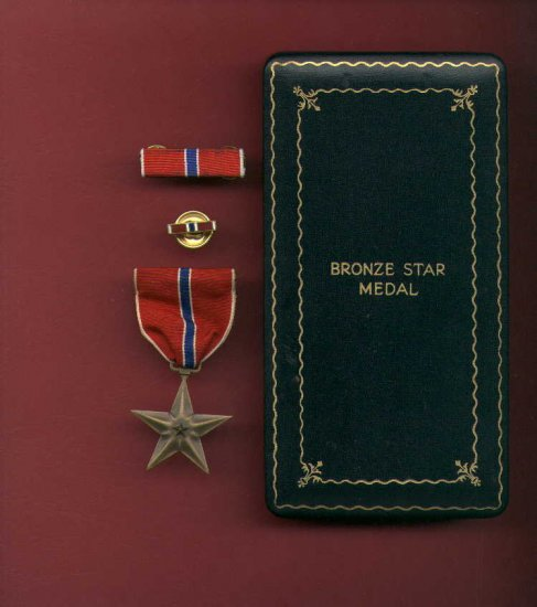 WWII Bronze Star medal in case with ribbon bar, lapel pin, Invasion money, stamps, etc.