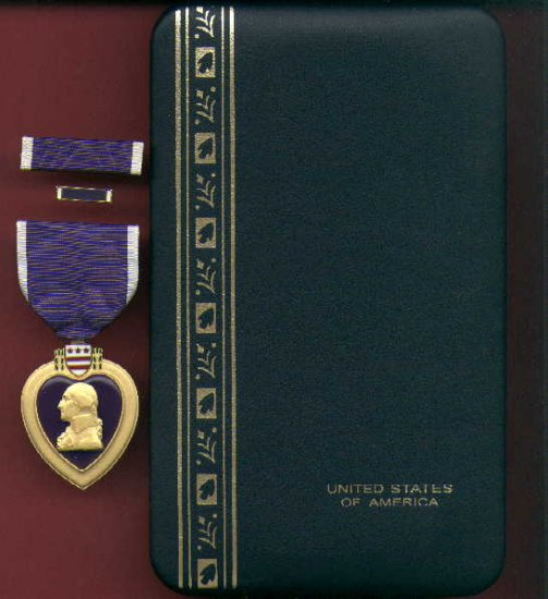 US Purple Heart medal in case with ribbon bar and lapel pin