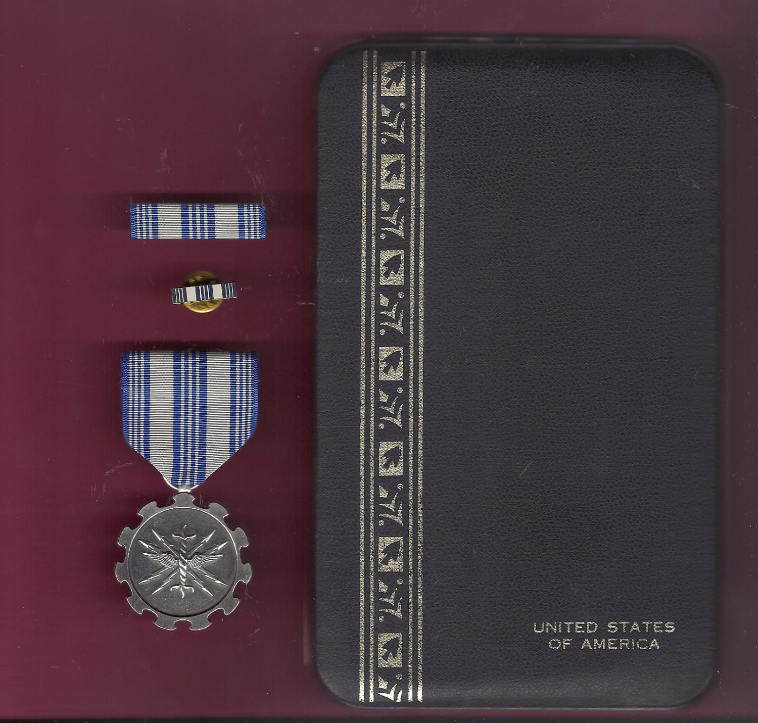Air Force Achievement medal in case with ribbon bar and lapel pin