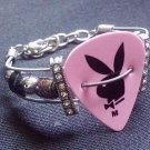 Guitar string bracelet from recycled strings Playboy bunny guitar pick