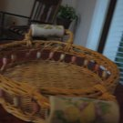 Vintage round wicker basket with side beading and fruit design ceramic handles