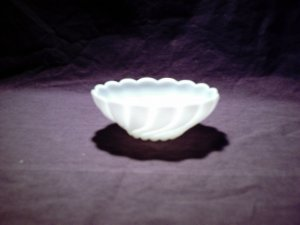 Medium sized white glass bowl swirled design (milk glass?)
