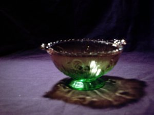 Unique amber and green glass bowl with pedestal