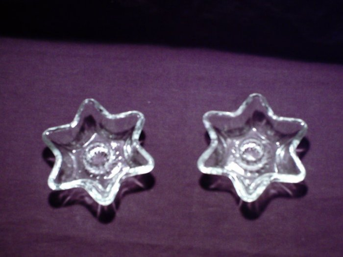 Star shaped cut glass taper candle holders