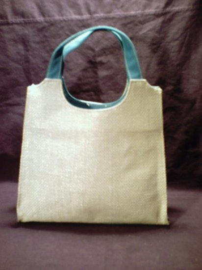 Tan and blue colored Estee Lauder handbag purse