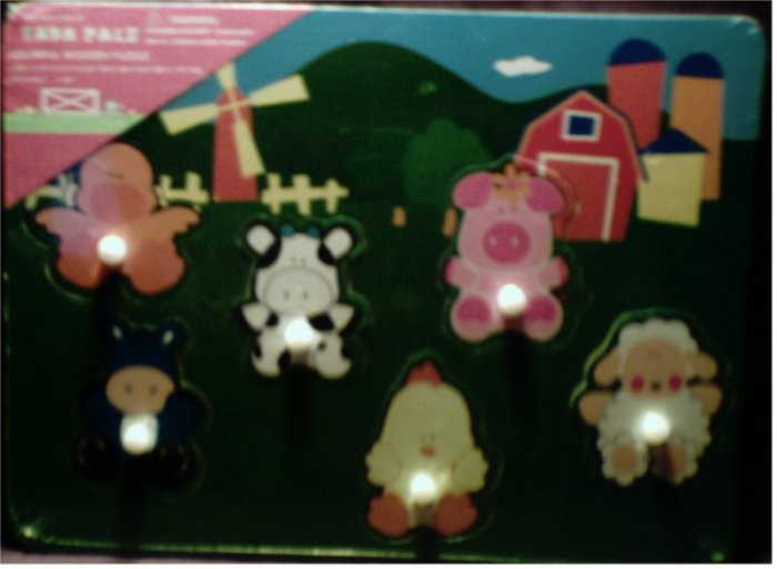 NIP Farm Pals colorful wooden puzzle with 6 animal pieces with handles