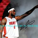 LEBRON JAMES AUTOGRAPHED 8x10 RP PHOTO MIAMI HEAT AWESOME
