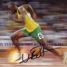 USAIN BOLT AUTOGRAPHED 8x10 RP PHOTO OLYMPICS GOLD MEDALIST WORLDS FASTEST MAN