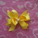 Yellow and white polka dot hairbow