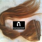 A Dark Blonde Hair Extension, Weft Hair Extension, Remy Dark Blonde Hair Weft