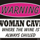 Warning Woman Cave Where the Wine is Always Chilled  Pink Metal Parking Sign