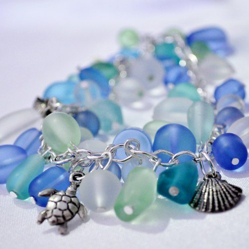 Sea glass charm bracelet with turtle and shell charms