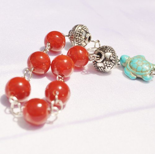 Red glass and turquoise bracelet with turtle bead accent
