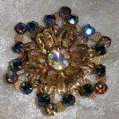 Vintage pin brooch flower star blue rhinestone filigree work 3-D affect