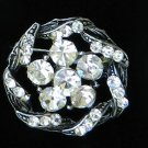 Vintage pin brooch wreath clear rhinestones black background twist and turns