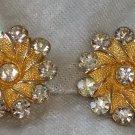 Signed BSK Gold tone textured flower earrings clear rhinestone vintage bling