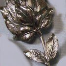 Silver tone leafy flower bud pin signed Botticelli vintage pin brooch 1969-78