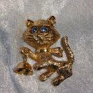 Cat blue rhinestone eyes goldton bell moves vintage Pin Brooch Avon 1974
