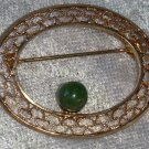 Gold tone filigree. oval pin brooch vintage green stone bead   ME TT