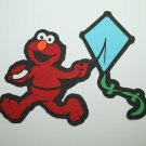 Sesame street Elmo flying a kite die cut